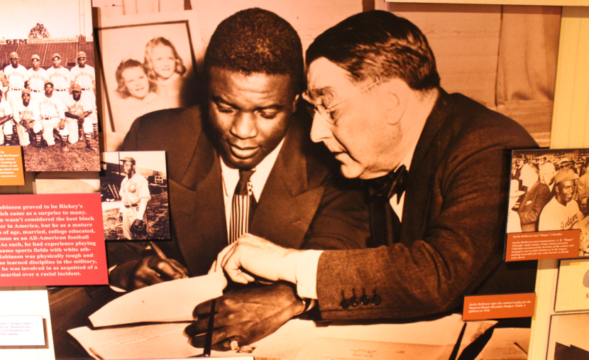 Jackie Robinson with Branch Rickey signing his Major League Contract