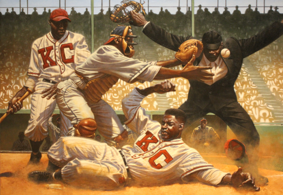 "Kadir Nelson's ""Safe At Home"" painting featuring Jackie Robinson hangs proudly inside the Negro Leagues Baseball Museum."